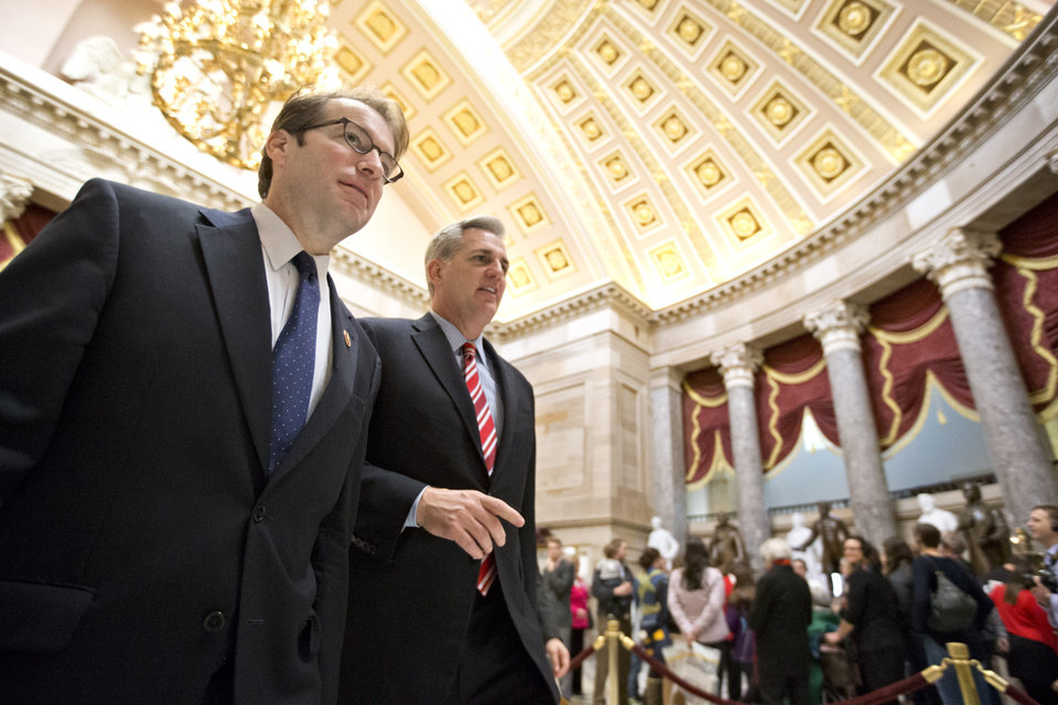 Rep. Peter Roskam, R-Ill., left, and House Majority Whip Kevin McCarthy of Calif., shuttle between the House floor and the offices of House Speaker John Boehner, on Capitol Hill in Washington, Friday, Jan. 4, 2013, as the new 113th Congress meets for the its first full day. At last, the storm-racked Northeast got a House floor vote on billions in disaster relief aid for victims of October's Superstorm Sandy, but only after a host of East Coast Republican lawmakers threatened a near mutiny against GOP Speaker John Boehner. (AP Photo/J. Scott Applewhite)