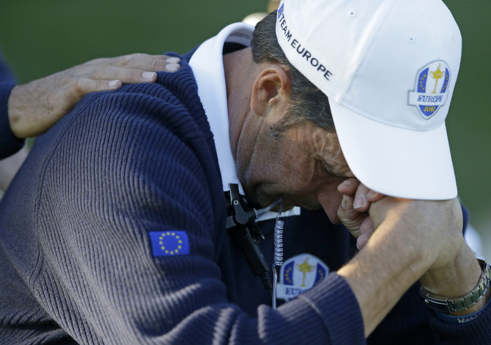 European team captain Jose Maria Olazabal holds his head down on the 17th hole during a singles match at the Ryder Cup PGA golf tournament Sunday, Sept. 30, 2012, at the Medinah Country Club in Medinah, Ill. (AP Photo/Chris Carlson)  ORG XMIT: PGA191