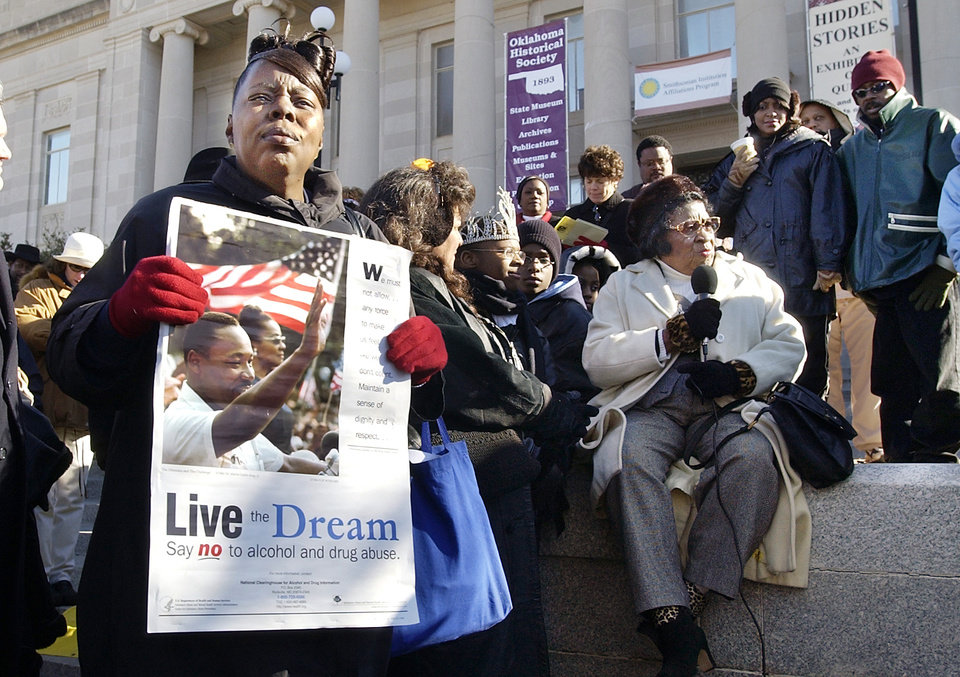 Photo - OKLAHOMA CITY, OK. MONDAY 1-19-04. MARTIN LUTHER KING JR. DAY. End of the silent march at the State Historical Society and bell ringing Monday morning.  Dorothy J. Faulkner, of Okla. City, holding a Dr. King poster at the State Historical Society Monday morning as Clara Luper speaks to the crowd. Staff photo by Paul B. Southerland