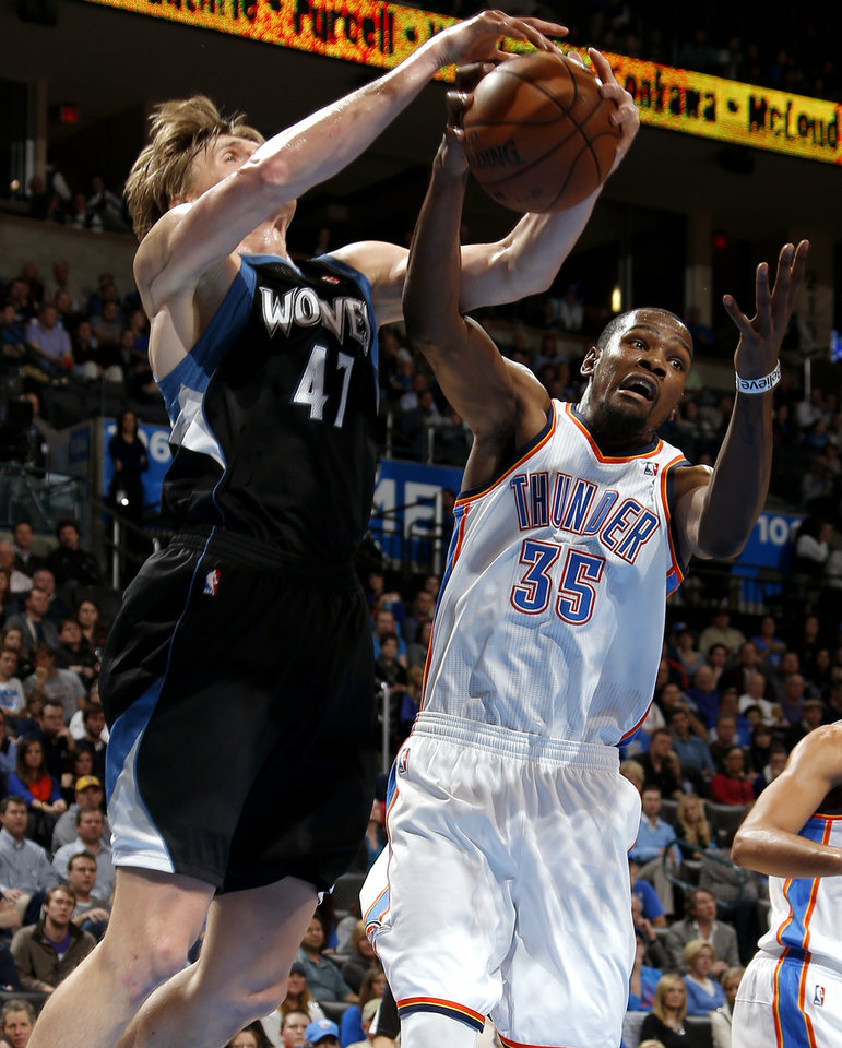 Photo - Oklahoma City's Kevin Durant (35) goes for the rebound beside Minnesota's Andrei Kirilenko (47) during an NBA basketball game between the Oklahoma City Thunder and the Minnesota Timberwolves at Chesapeake Energy Arena in Oklahoma City, Wednesday, Jan. 9, 2013.  Oklahoma City won 106-84. Photo by Bryan Terry, The Oklahoman
