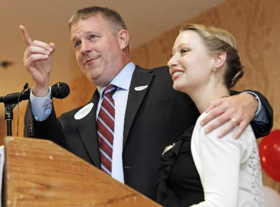 Photo - Kevin  Calvey speaks to supporters with his wife, Toni  Calvey, by his side during the primary watch party for Kevin  Calvey, a Republican candidate for Oklahoma's 5th Congressional District seat, at the Stone Garden Hotel and Conference Center in Oklahoma City, Tuesday, July 27, 2010. (AP Photo/The Oklahoman, Nate Billings)