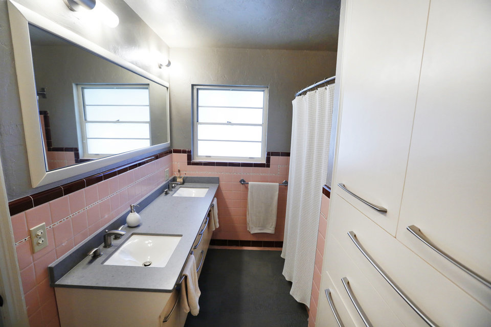 Photo - The built-in linen closet in the Deatches' master bath, at right, was not only rehabbed but reoriented.  Steve Gooch - The Oklahoman