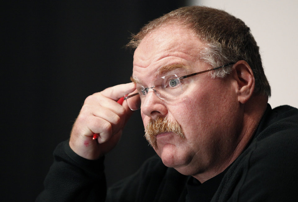 FILE - This Nov. 21, 2011 file photo shows Philadelphia Eagles head coach Andy Reid pausing while speaking during a media availability at their NFL football training facility in Philadelphia. Reid arrived in Kansas City on Friday, Jan. 4, 2012, and the Chiefs are close to making an official announcement that he will become their next coach.(AP Photo/Alex Brandon, File)