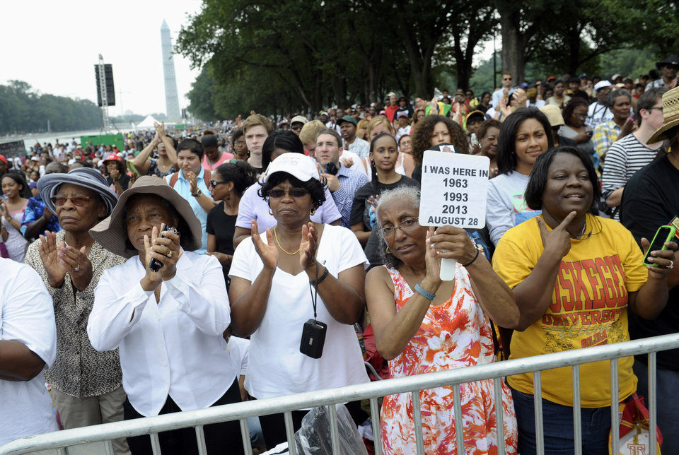 Photo - Three women who attended previous March's on Washington, from left, Armanda Hawkins of Memphis, Vera Moore of Washington, and Betty Waller Gray of Richmond, Va., (holding sign) listen to the speakers during the March on Washington, Wednesday, Aug. 28, 2013, at the Lincoln Memorial in Washington.  President Barack Obama will speak later Wednesday. (AP Photo/Susan Walsh)