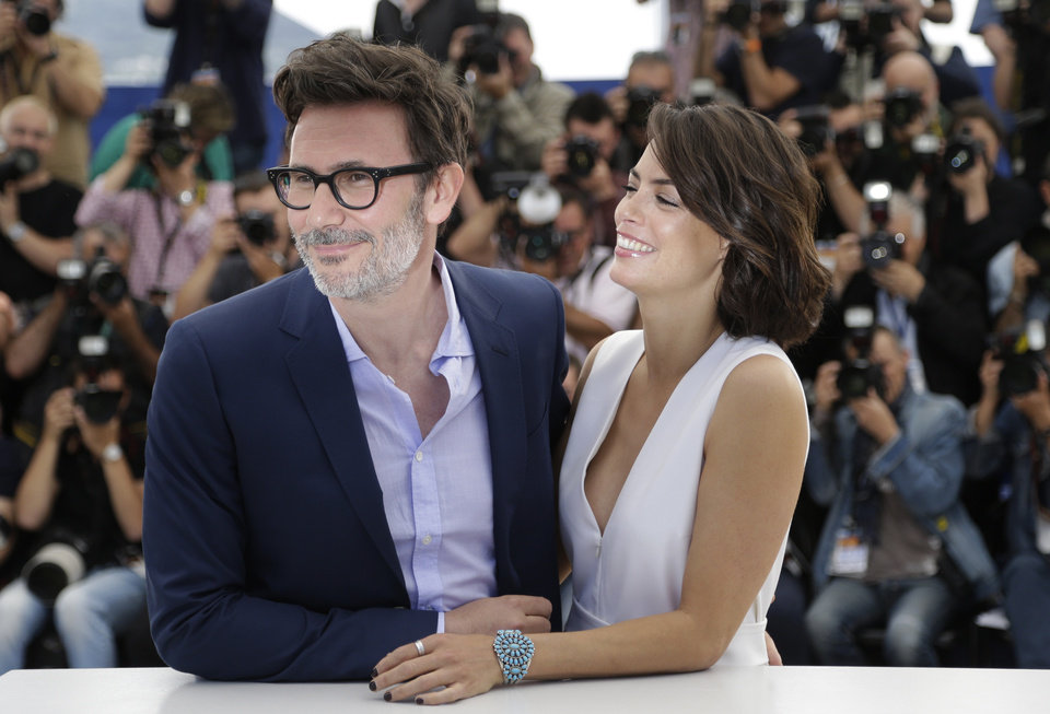 Photo - Director Michel Hazanavicius, left, and actress Berenice Bejo pose for photographers during a photo call for The Search at the 67th international film festival, Cannes, southern France, Wednesday, May 21, 2014. (AP Photo/Thibault Camus)