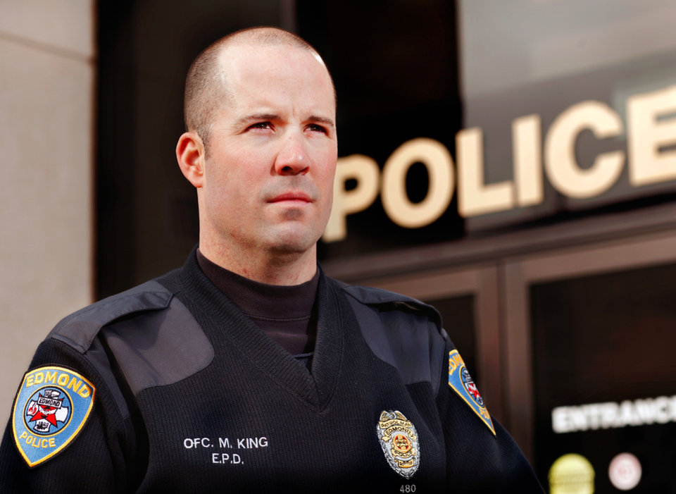 Edmond Police Department has an Oasiss program which offers assistance and support for fellow officers and their families in stressful situations. Officer Michael King is the team leader. He is photographed in front of the department's headquarters in downtown Edmond on  Jan. 18, 2012.     Photo by Jim Beckel, The Oklahoman