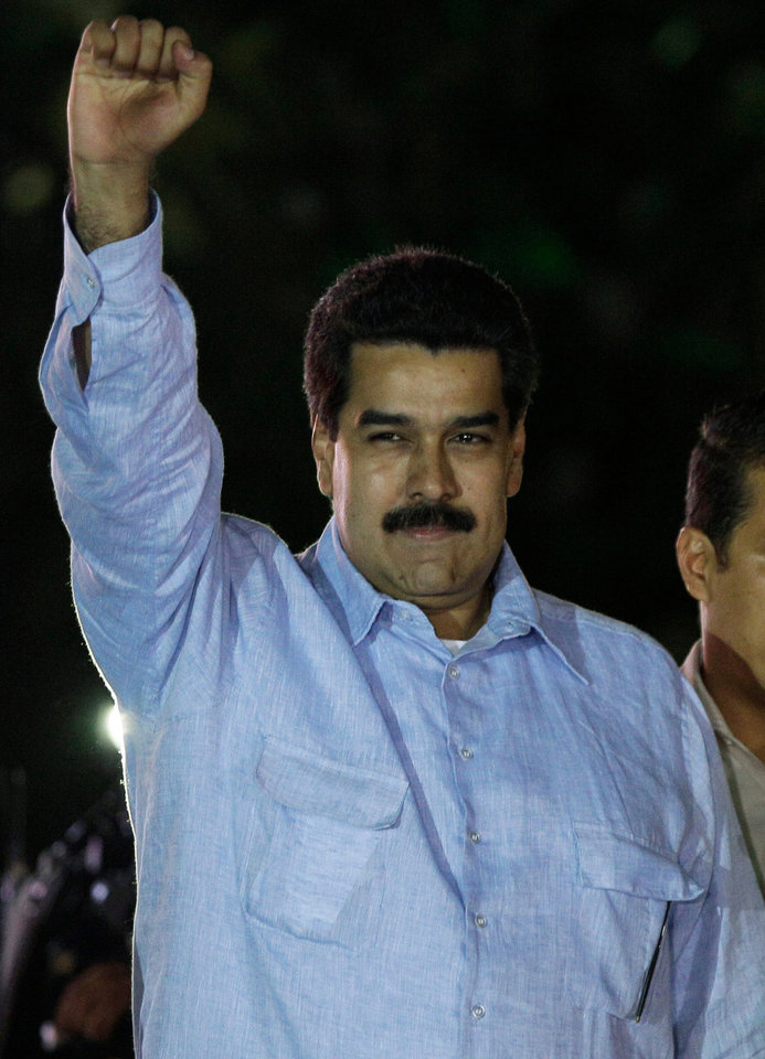 Venezuela's Vice-President Nicolas Maduro gestures as he arrives for the 8th anniversary of the ALBA group in Caracas, Venezuela, Saturday, Dec. 15, 2012. President Hugo Chavez has been receiving daily visits from former Cuban leader Fidel Castro while recovering from cancer surgery in Cuba, a Venezuelan government official said Saturday night. (AP Photo/Fernando Llano)