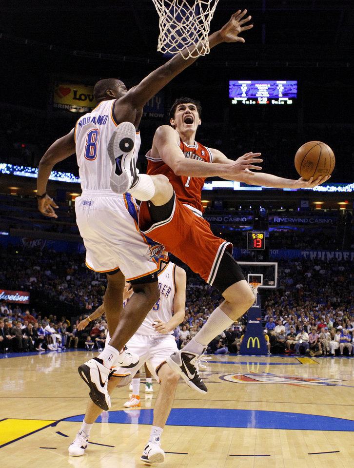 Photo - Oklahoma City's Nazr Mohammed (8) defends Milwaukee's Ersan Ilyasova (7)during the NBA basketball game between the Oklahoma City Thunder and the Milwaukee Bucks at the Oklahoma City Arena, Wednesday, April 13, 2011. Photo by Bryan Terry, The Oklahoman