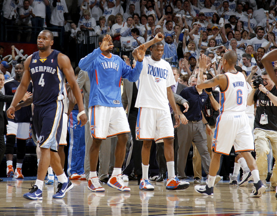 Photo - Oklahoma City's Serge Ibaka (9), Kevin Durant (35), and  Eric Maynor (6) celebrate as Sam Young (4) of Memphis walks off the court after game five of the Western Conference semifinals between the Memphis Grizzlies and the Oklahoma City Thunder in the NBA basketball playoffs at Oklahoma City Arena in Oklahoma City, Wednesday, May 11, 2011. Photo by Bryan Terry, The Oklahoman