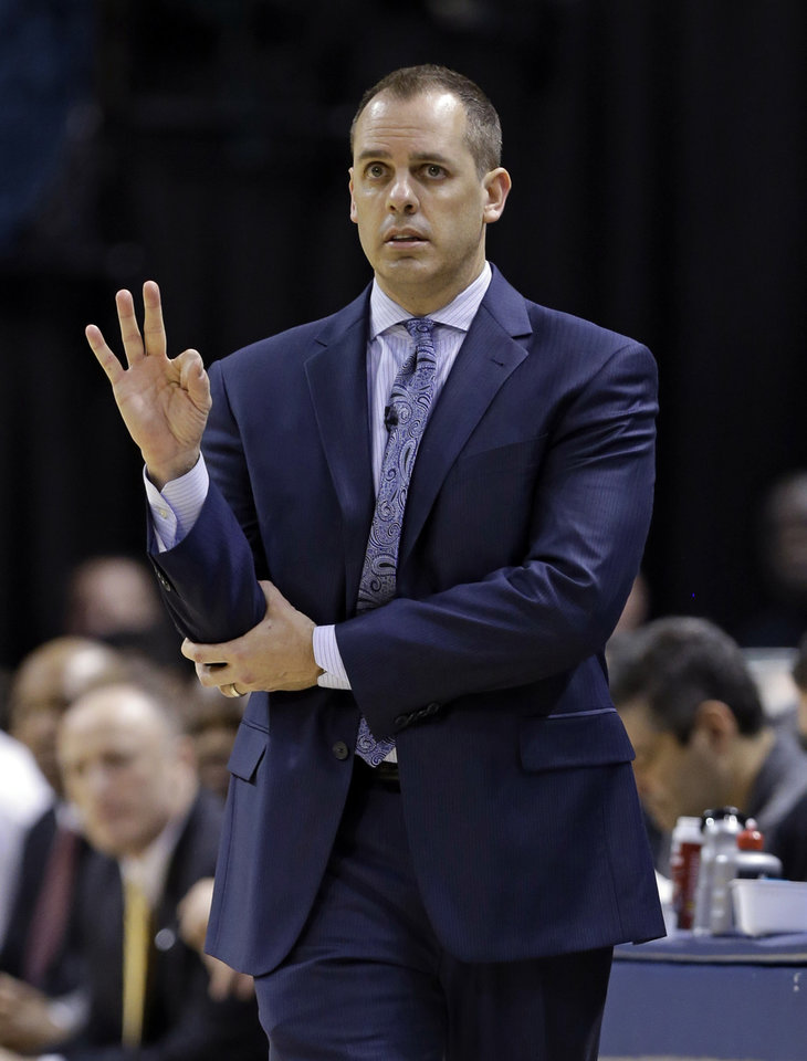 Photo - Indiana Pacers coach Frank Vogel calls a play for his team during the first half of the Pacers' NBA basketball game against the New York Knicks in Indianapolis, Thursday, Jan. 16, 2014. (AP Photo/Michael Conroy)