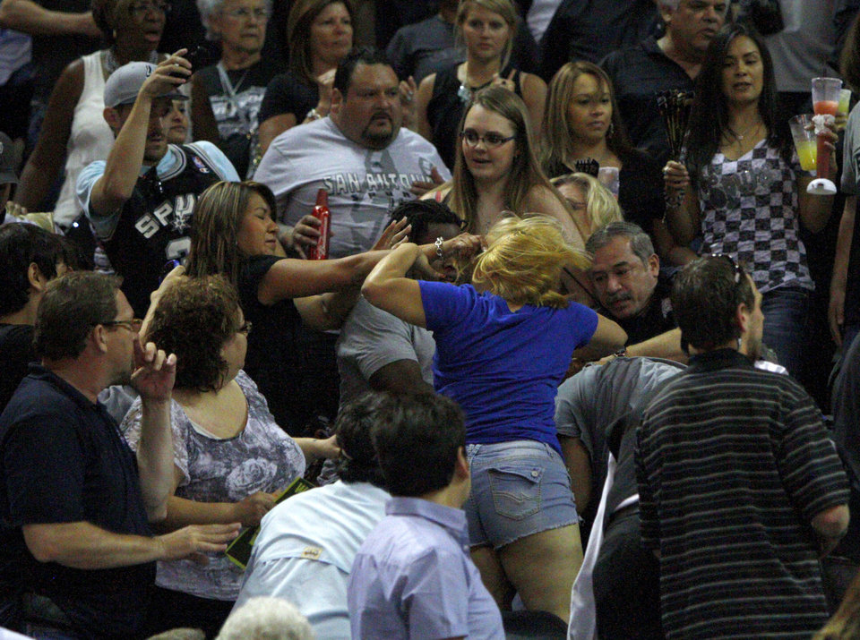 Photo - A fight breaks out in the stands during Game 2 of the Western Conference Finals between the Oklahoma City Thunder and the San Antonio Spurs in the NBA playoffs at the AT&T Center in San Antonio, Texas, Tuesday, May 29, 2012. Photo by Bryan Terry, The Oklahoman
