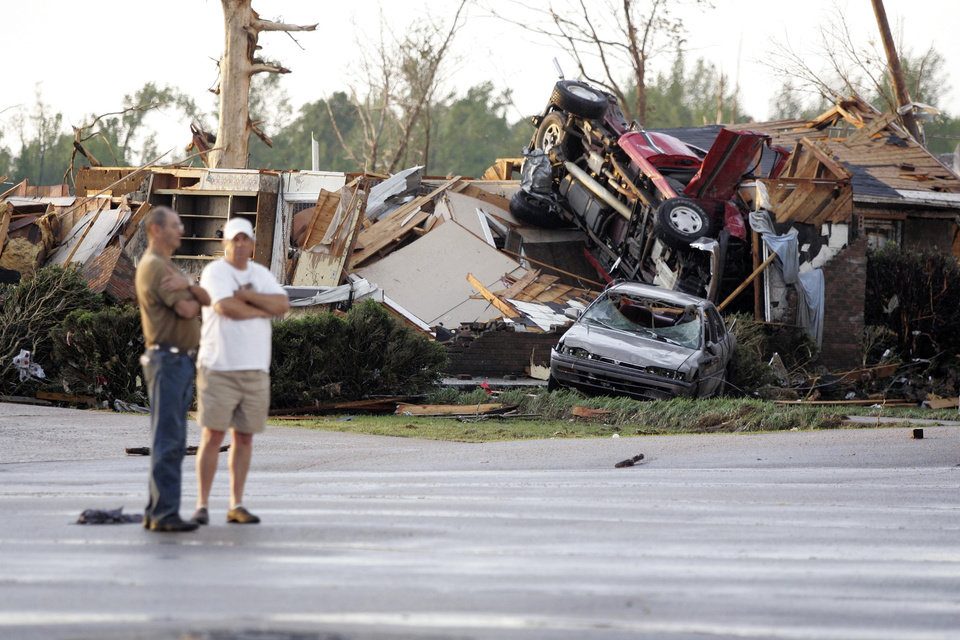 Photo - Residents survey the damage  after a tornado touched down, Wednesday, April 27, 2011 in Smithville, Miss. (AP Photo/Northeast Mississipi Daily Journal, Thomas Wells)
