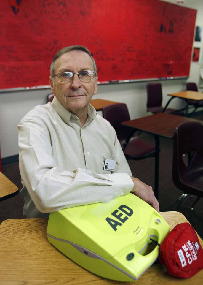 Edmond Memorial High School teacher David Duke shows the defibrillator which saved his life at the school in Edmond, OK, Monday, April 13, 2009. He survived a heart attack at school, thanks to the use of this defibrillator which the school had on hand. He is now firm believer that each school should have one. BY PAUL HELLSTERN, THE OKLAHOMAN