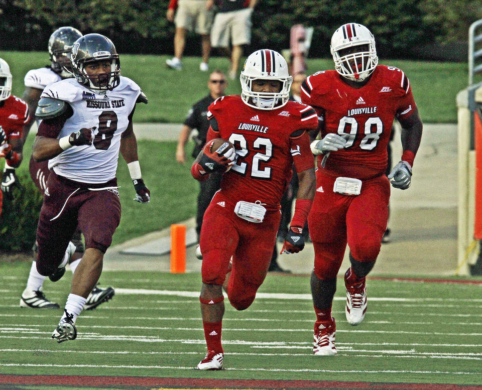 Louisville cornerback Jordan Paschal (22) races toward the goal line after recovering a Missouri State fumble in the fourth quarter of an NCAA college football game in Louisville, Ky., Saturday, Sept. 8, 2012. Paschal was caught at the 1-yard line, but No. 23 Louisville scored on the next play. Chasing Paschal is Cedric Miller (8). Louisville won 35-7. (AP Photo/Garry Jones)