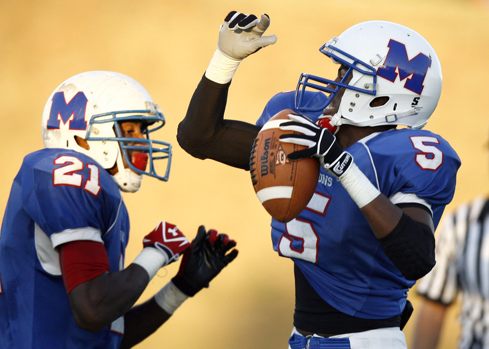 Millwood\'s Shevin Patton (5) and Clifford Lawrence (21) celebrate a touchdown during the high school football game between Millwood and Star Spencer, Friday, Sept. 3, 2010, at Millwood High School in Oklahoma City. Photo by Sarah Phipps, The Oklahoman