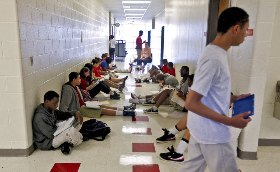 Photo - HEAT / HOT WEATHER: John Marshall High School math teacher Cassi Yarbrough teaches her class in the hallway to help keep the students cooler while there was no air conditioning at John Marshall High School on Friday, March 30 2012, in Oklahoma City, Oklahoma.  Photo by Chris Landsberger, The Oklahoman