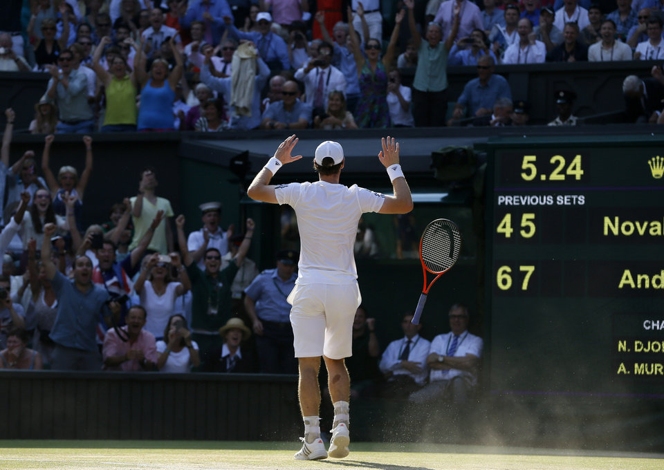 Photo - Andy Murray of Britain reacts after defeating Novak Djokovic of Serbia during the Men's singles final match at the All England Lawn Tennis Championships in Wimbledon, London, Sunday, July 7, 2013. (AP Photo/Kirsty Wigglesworth)