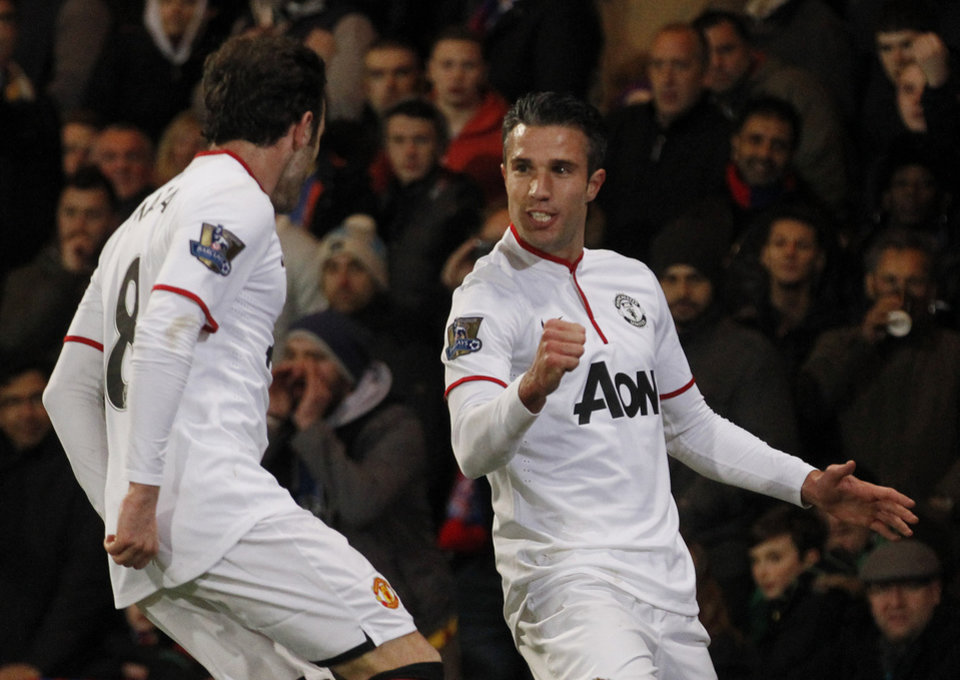 Photo - Manchester United's Robin Van Persie, right, celebrates his penalty goal against Crystal Palace with teammate Juan Mata during their English Premier League soccer match at Selhurst Park, London, Saturday, Feb. 22, 2014. (AP Photo/Sang Tan)
