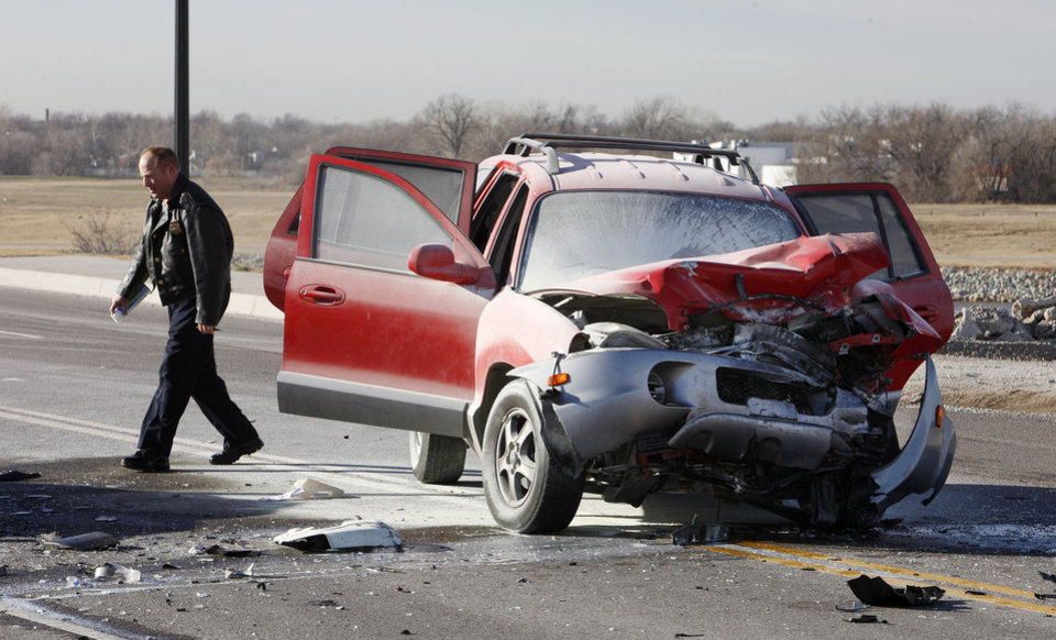 Photo - Oklahoma City police investigate a fatality accident on south Western Ave just south of I-40 in Oklahoma City Monday, Feb. 11, 2013. The fatality was in the vehicle shown.  Photo by Paul B. Southerland, The Oklahoman