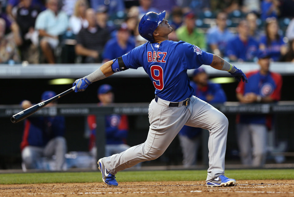 Photo - Chicago Cubs' Javier Baez flies out against the Colorado Rockies in the fifth inning of the Rockies' 13-4 victory in a baseball game in Denver on Wednesday, Aug. 6, 2014. (AP Photo/David Zalubowski)