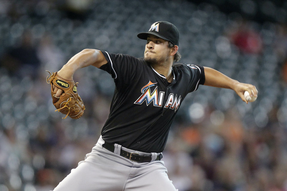 Miami Marlins pitcher Brad Hand throws during the first inning of a baseball game against the Houston Astros, Friday, July 25, 2014, in Houston. (AP Photo/Patric Schneider)