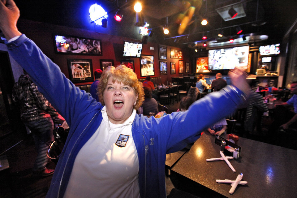 Lisa Warren gets the fans fired up at a Blue Alliance watch party for her Yukon Chapter, Tuesday, January 15, 2013. Blue Alliance is an organization of Oklahoma City Thunder fans that meet across the state to watch the games.  Photo By David McDaniel/The Oklahoman