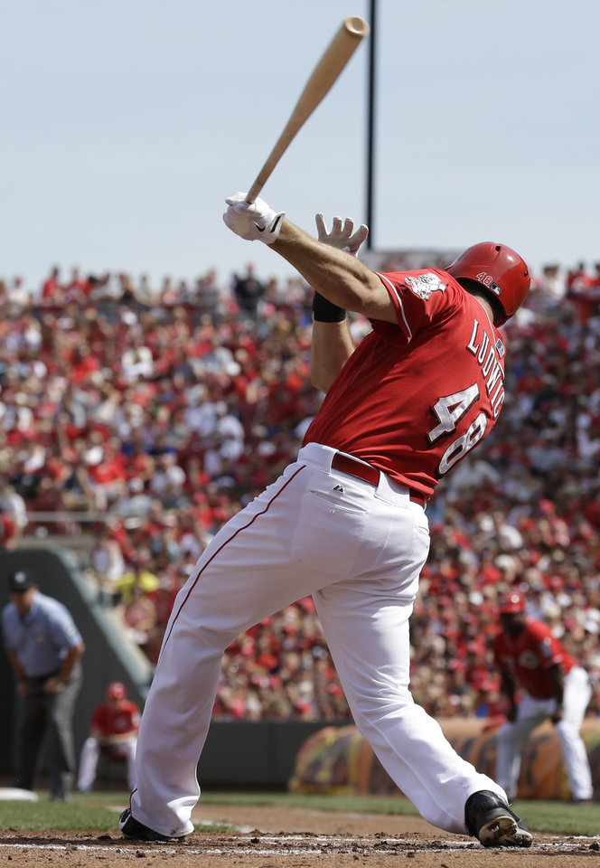 Photo - Cincinnati Reds' Ryan Ludwick gets a hit off Toronto Blue Jays starting pitcher J.A. Happ to drive in two runs in the first inning of a baseball game on Saturday, June 21, 2014, in Cincinnati. (AP Photo/Al Behrman)