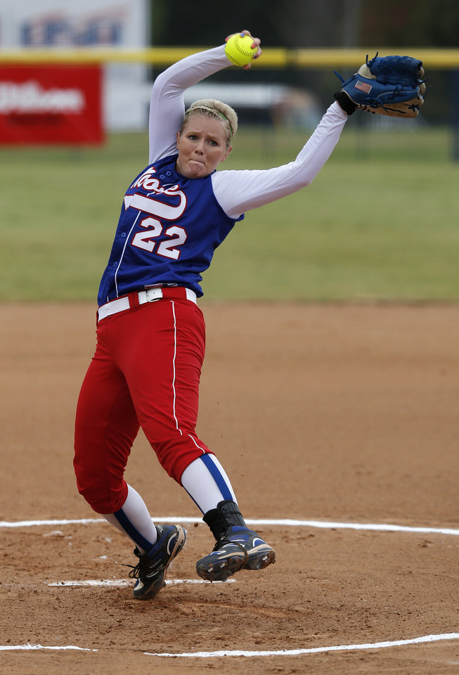 Photo - Moore's Jenna Lynn (22) pitches during the 6A state softball semifinals game between Moore and Broken Arrow at ASA Hall of Fame Stadium in Oklahoma City, Okla., Friday, Oct. 12, 2012.  Photo by Garett Fisbeck, The Oklahoman