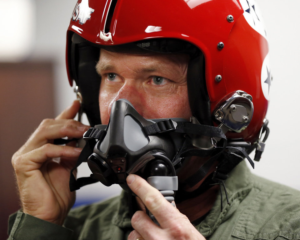 Professional golfer Scott Verplank tries on his helmet during training before a media flight in an F-16 from the USAF Thunderbirds at Tinker Air Force Base in Midwest City, Okla., Friday, June 20, 2014. The Thunderbirds will perform Saturday and Sunday at the Star Spangled Salute Air Show. Photo by Nate Billings, The Oklahoman