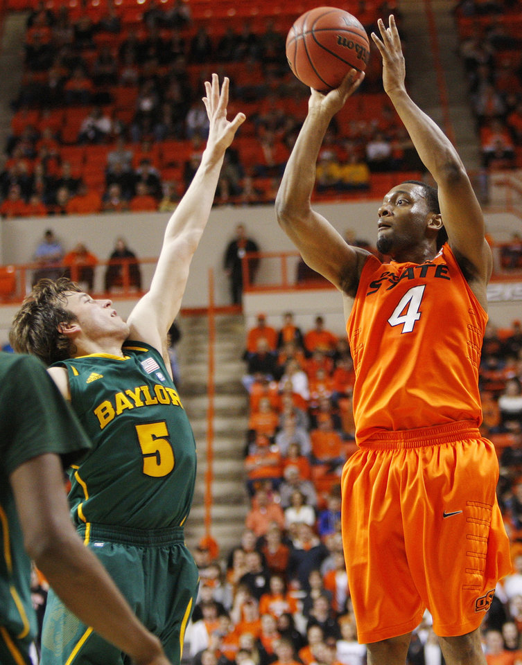 OSU's Brian Williams (4) shoots over Baylor's Brady Heslip (5) in the first half of a men's college basketball game between the Oklahoma State University Cowboys and the Baylor University Bears at Gallagher-Iba Arena in Stillwater, Okla., Saturday, Feb. 4, 2012. Photo by Nate Billings, The Oklahoman