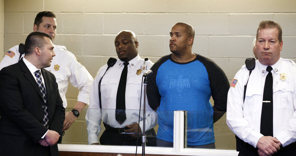 Photo - Gai Scott, second from right, of Randolph. Mass., stands during an arraignment, Monday, March 31, 2014, in Plymouth, Mass. Scott was arraigned on charges in the shooting of his uncle and reality TV star Benzino, who was shot Saturday during a funeral procession. (AP Photo/The Patriot Ledger, Greg Derr, Pool)