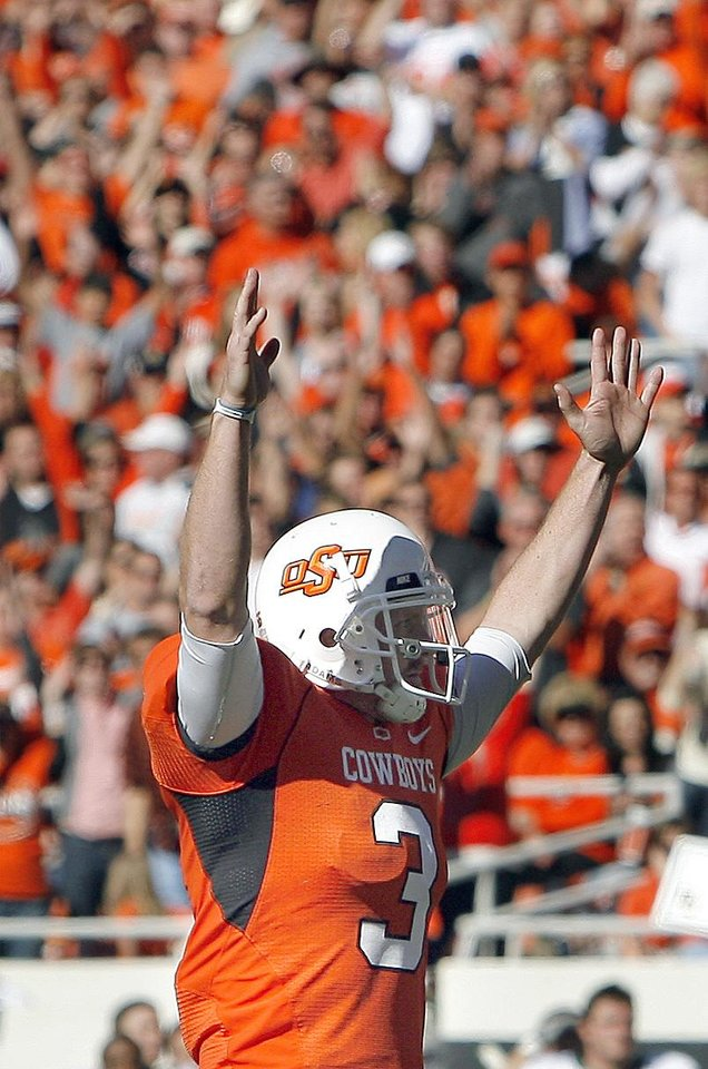 OSU\'s Brandon Weeden celebrates a touchdown during the college football game between the Oklahoma State University Cowboys (OSU) and the Baylor University Bears at Boone Pickens Stadium in Stillwater, Okla., Saturday, Nov. 6, 2010. Photo by Sarah Phipps, The Oklahoman