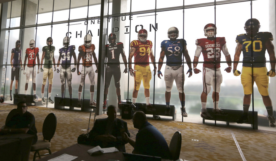 Photo - Window art of football players adorn the windows at the hotel hosting the NCAA college Big 12 Conference football media days in Dallas, Monday, July 21, 2014. (AP Photo/LM Otero)
