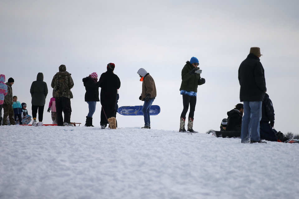 Photo - Sledders line up on a hill along W Hefner Road in Oklahoma City after a winter storm dropped another layer of snow in Oklahoma City, Wednesday, Feb. 17, 2021. [Bryan Terry/The Oklahoman]