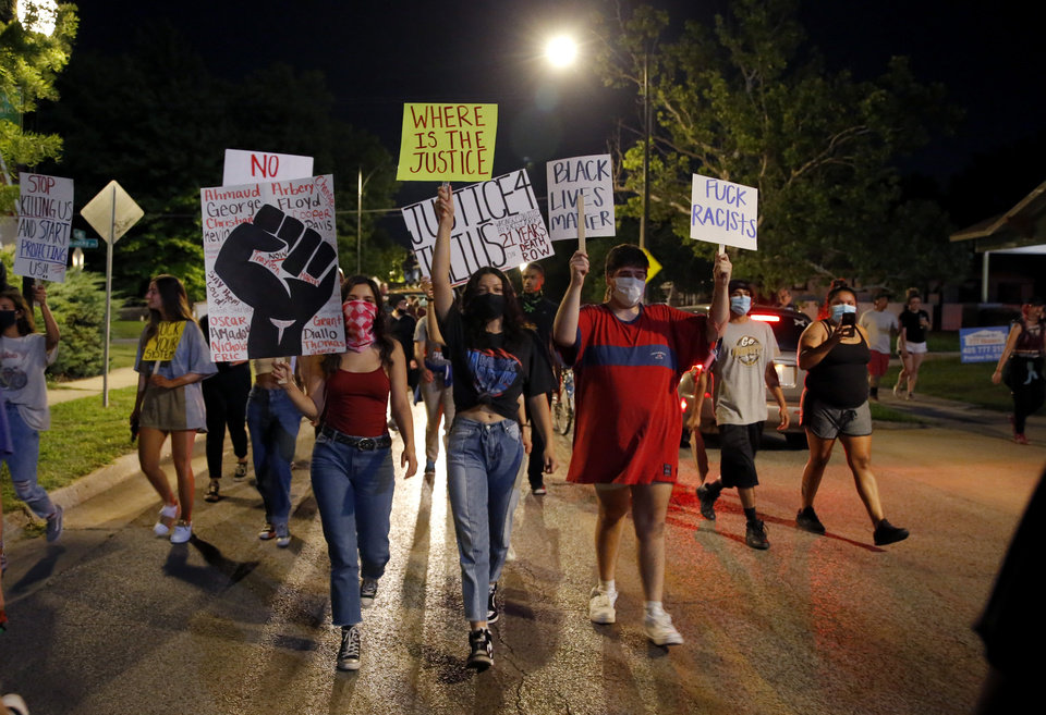 Photo - Protesters march in Oklahoma City, Saturday, May 30, 2020. The protest was in response to the death of George Floyd. [Sarah Phipps/The Oklahoman]