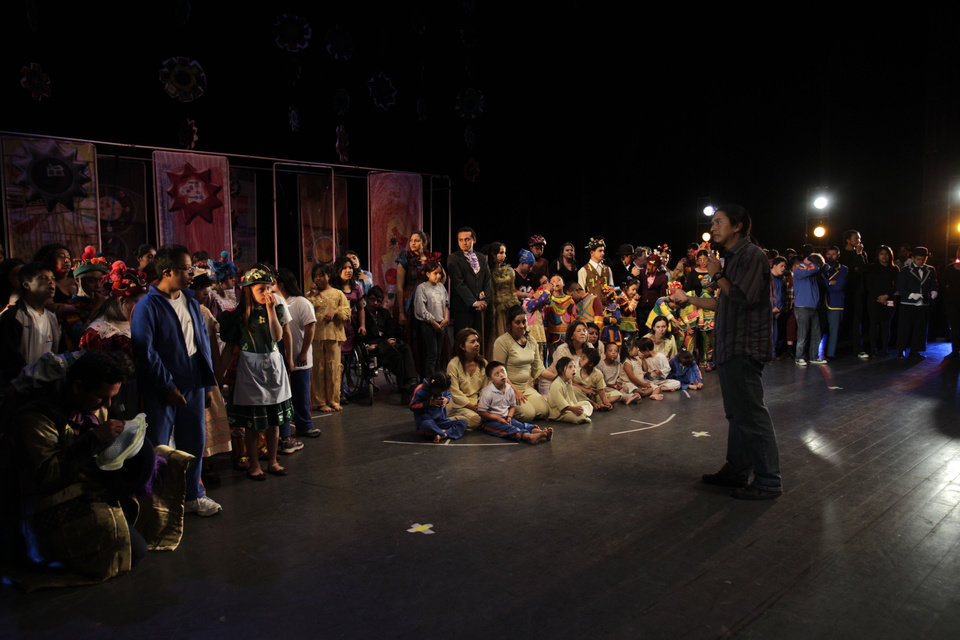 "In this Sept. 21, 2012 photo, Marco Bustos, director of ""Suenos,"" or �Dreams,� one of Ecuador's most successful musicals, speaks to cast members before their performance at the Casa de la Cultura theater in Quito, Ecuador. The musical is based in part on the dreams of young people with disabilities and is presented by the nonprofit foundation El Triangulo. (AP Photo/Dolores Ochoa)"