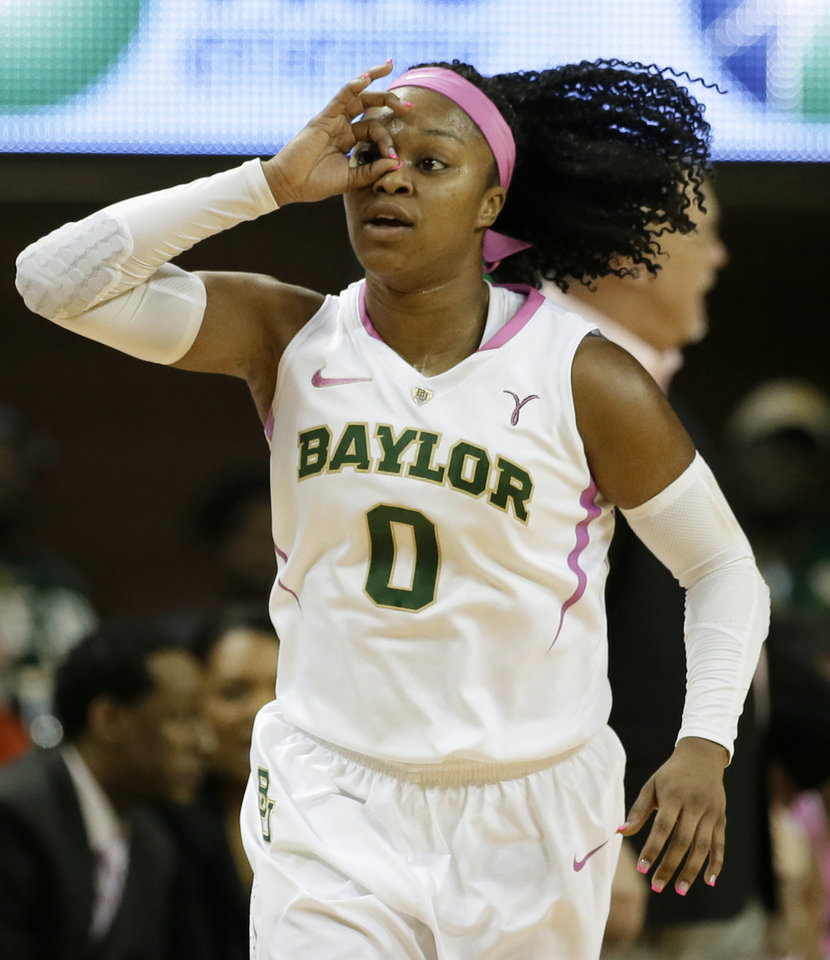 Photo - Baylor guard Odyssey Sims (0) celebrates after scoring a three-pointer against Oklahoma State in the first half of an NCAA women's college basketball games, Sunday, Feb. 9, 2014, in Waco, Texas. Both teams in the contest are wearing uniforms accenting in pink helping bring attention to breast cancer awareness. (AP Photo/Tony Gutierrez)