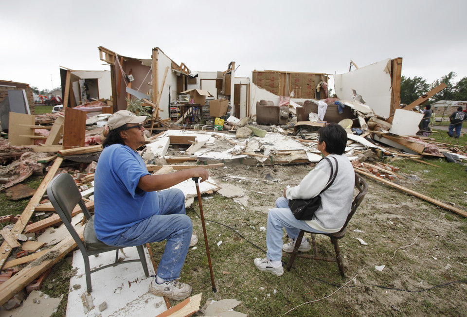 Photo - Clarence Gibson and his sister Bernice Gibson look at damage to Clarence's sons home on Kathy Drive in Tecumseh, Oklahoma May 11 , 2010. Photo by Steve Gooch, The Oklahoman
