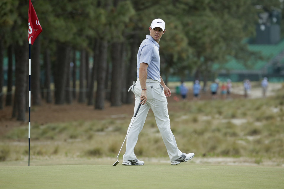 Photo - Rory McIlroy, of Northern Ireland, putts on the 12th hole during a practice round for the U.S. Open golf tournament in Pinehurst, N.C., Wednesday, June 11, 2014. The tournament starts Thursday. (AP Photo/Charlie Riedel)