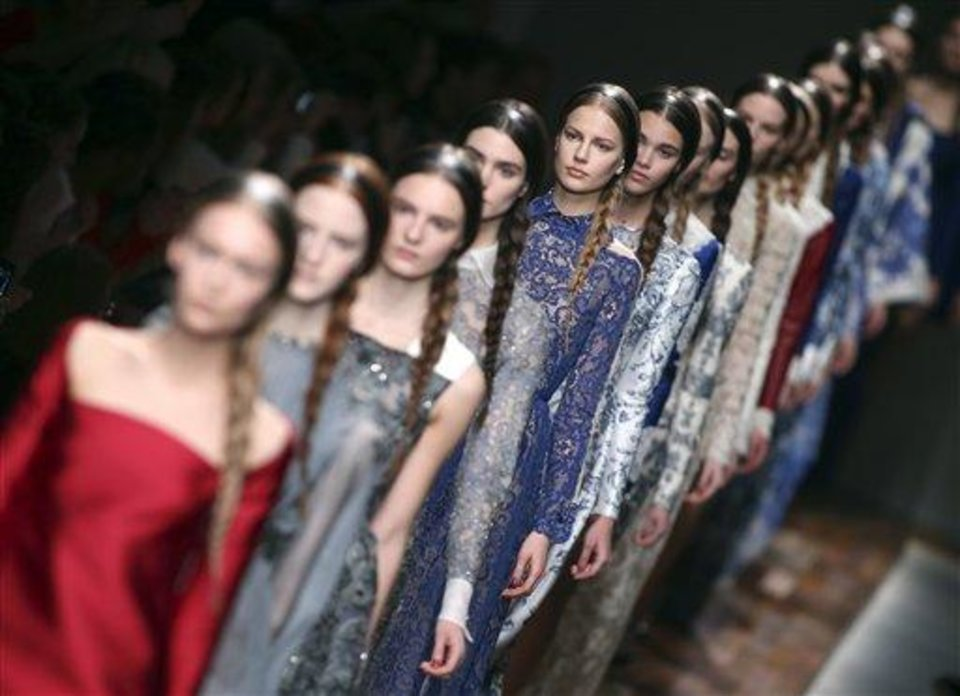 Models wear creations by fashion designers Maria Grazia Chiuri and Pier Paolo Piccioli for Valentino's Ready to Wear's Fall-Winter 2013-2014 fashion collection, presented, Tuesday, March 5, 2013 in Paris. (AP Photo/Thibault Camus)