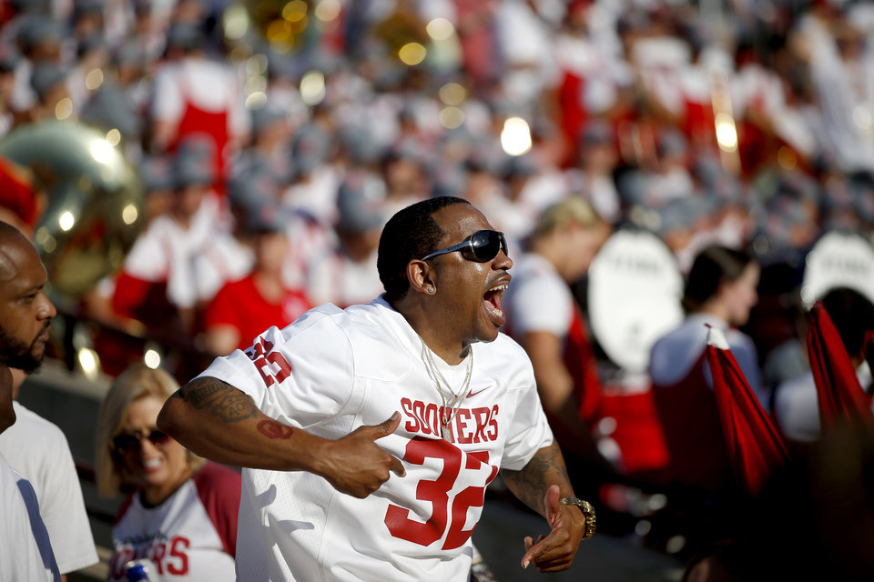 Photo - Oklahoma fan Corey Sutter cheers before a college football game between the University of Oklahoma Sooners (OU) and the Houston Cougars at Gaylord Family-Oklahoma Memorial Stadium in Norman, Okla., Sunday, Sept. 1, 2019. Oklahoma won 49-31. [Bryan Terry/The Oklahoman]