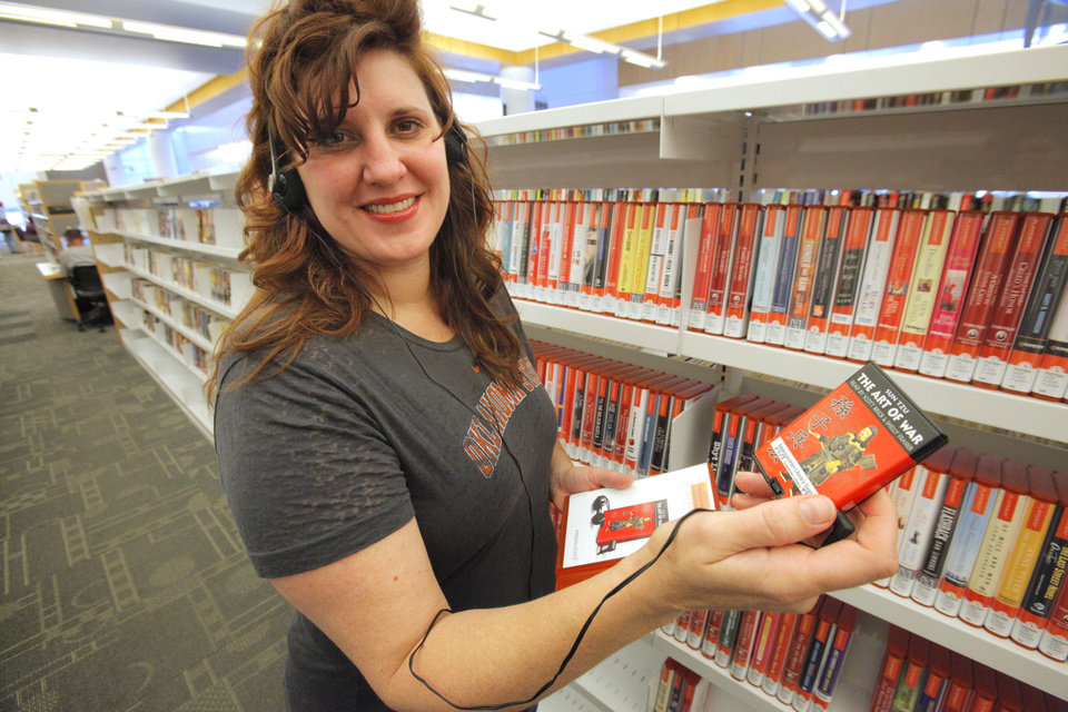 Oklahoma City Library Marketing Director Kim Terry on Friday shows one of the new Playaway devices used to listen to audiobooks, Photo By David McDaniel/The Oklahoman