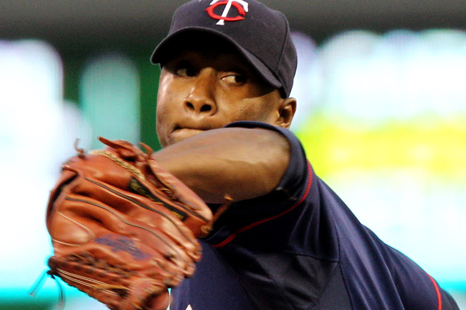 Photo -   Minnesota Twins starting pitcher Samuel Deduno (21) throws against the Cleveland Indians during the first inning of a baseball game, Monday, Sept. 10, 2012, in Minneapolis. (AP Photo/Genevieve Ross)