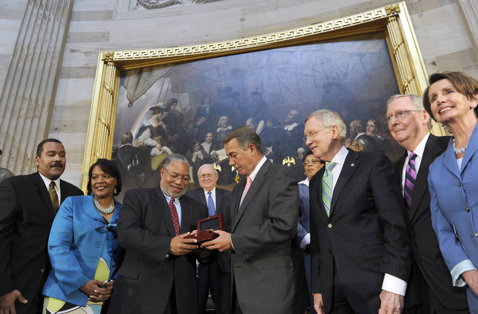 Photo - House Speaker John Boehner of Ohio, presents Lonnie Bunch III with a Congressional Gold Medal in honor of the late  Dr. and Mrs. Martin Luther King, Jr., who were instrumental in the passage of the Civil Rights Act of 1964, Tuesday, June 24, 2014, during a 50th anniversary ceremony of the law in the Capitol Rotunda on Capitol Hill in Washington. From left are, Dexter King, Bernice King, Bunch, Sen. Carl Levin, D-Mich., Boehner, Rep. Marcia Fudge, D-Ohio, Senate Majority Leader Harry Reid of Nev., Senate Minority Leader Mitch McConnell of Ky., and House Minority Leader Nancy Pelosi of Calif.  (AP Photo/Susan Walsh)