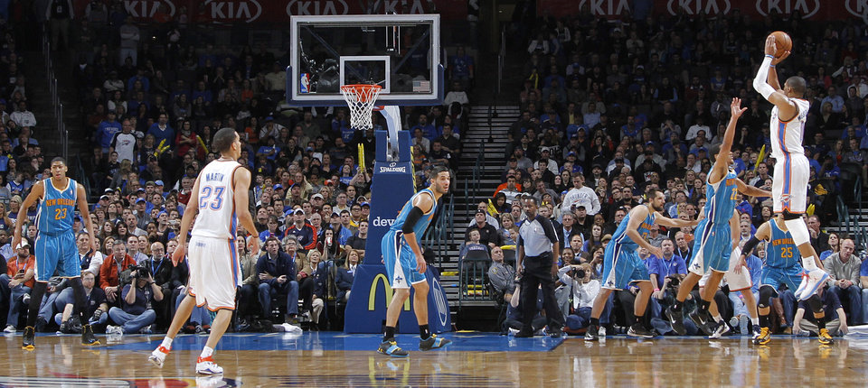 Oklahoma City Thunder\'s Russell Westbrook (0) shoots a three over New Orleans Hornets\' Brian Roberts (22) during the NBA basketball game between the Oklahoma CIty Thunder and the New Orleans Hornets at the Chesapeake Energy Arena on Wednesday, Dec. 12, 2012, in Oklahoma City, Okla. Photo by Chris Landsberger, The Oklahoman