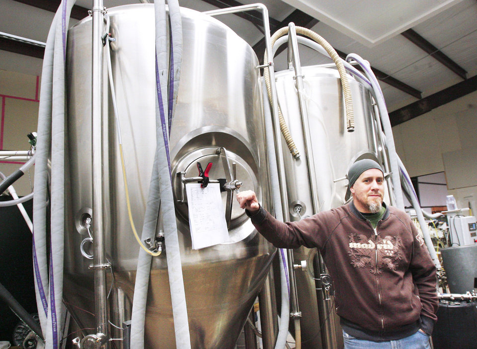 Photographer J.D. Merryweather has turned his passion for home brewing into a new business venture, COOP Ale Works, which will open next month. PHOTO  BY PAUL B. SOUTHERLAND,  THE OKLAHOMAN