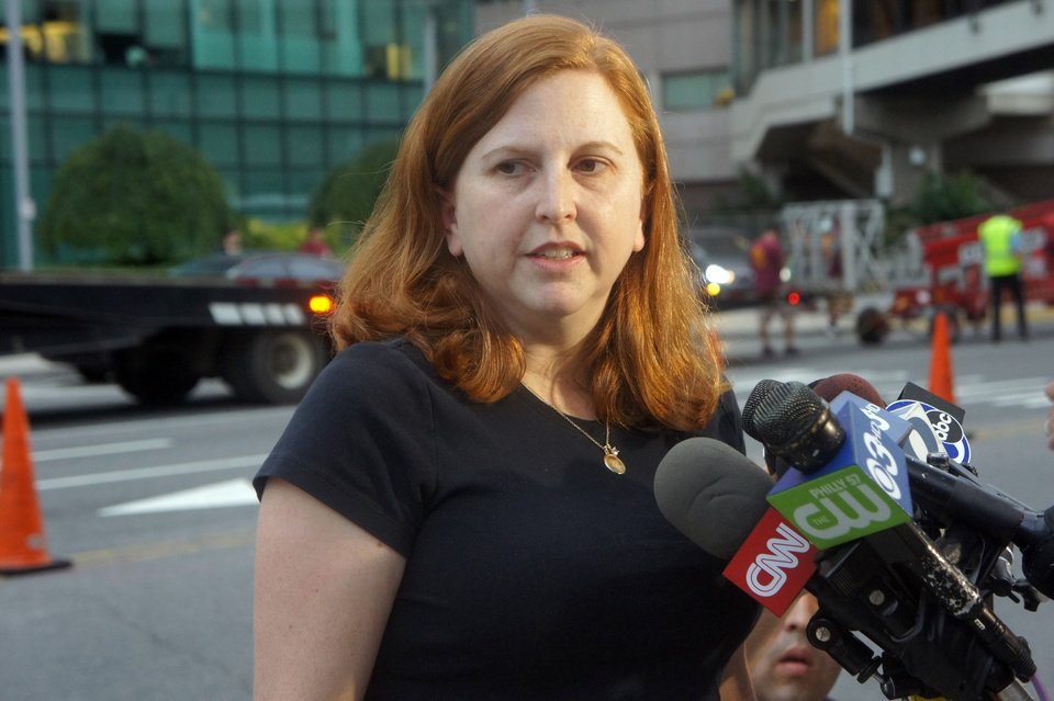 Photo - Sharon Ruddock, the aunt of Sarah Murnaghan, talks to reporters outside the Children's Hospital of Philadelphia after the 10-year-old underwent a six-hour double-lung transplant as a result of her severe cystic fibrosis, Wednesday, June 12, 2013. Ruddock said her niece never would have received the transplant without a judge's ruling that made her eligible for adult donor lungs. (AP Photo/Keith Collins)