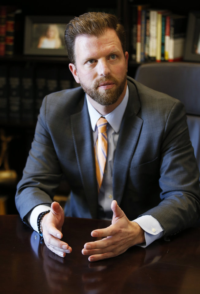 Photo -  State Rep. Jason Dunnington, D-Oklahoma City, is pictured on Wednesday in his office at the state Capitol in Oklahoma City. [AP Photo/Sue Ogrocki]