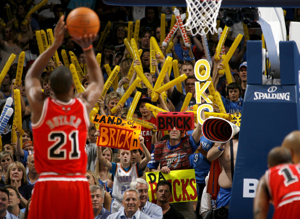 Fans try to distract Chicago's Jimmy Butler (21) during the NBA basketball game between the Chicago Bulls and the Oklahoma City Thunder at Chesapeake Energy Arena in Oklahoma City, Sunday, April 1, 2012. Photo by Sarah Phipps, The Oklahoman