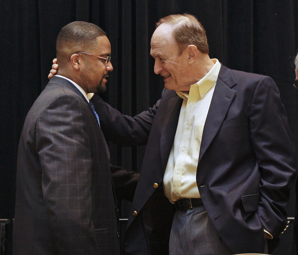 Former LSU coach Dale Brown, right, talks with Missouri coach Frank Haith, left, after Haith was given the U. S. Basketball Writers Association NCAA college basketball coach of the year award on Friday, March 30, 2012, in New Orleans. (AP Photo/Mark Humphrey) ORG XMIT: LAMH111